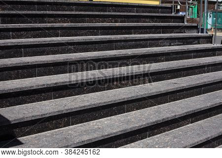 Granite Steps. Dark Steps Removed From The Bottom. Wide Stone Stairway Often Seen On Monuments And L
