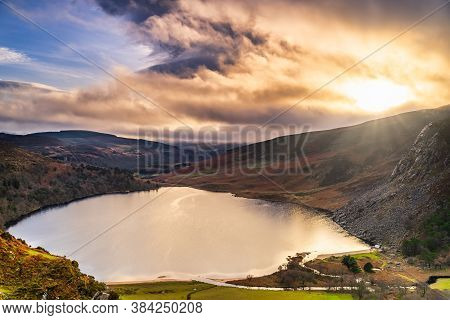 Dramatic Sunset At Lake Lough Tay Or The Guinness Lake In County Wicklow Where Vikings Village, Katt