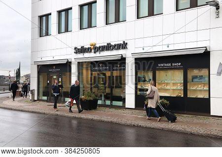 Gothenburg, Sweden - August 27, 2018: People Walk By Sefina Pantbank Pawnshop In Gothenburg, Sweden.