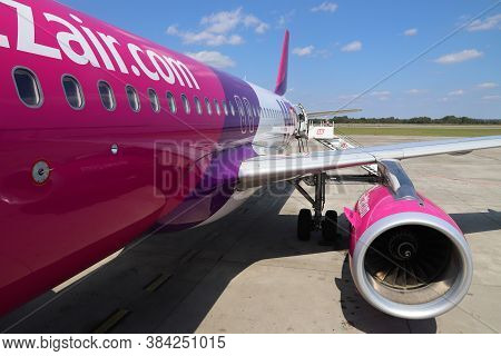 Katowice, Poland - August 22, 2018: Passengers Board Low Cost Airline Wizz Air Airbus A320 Aircraft