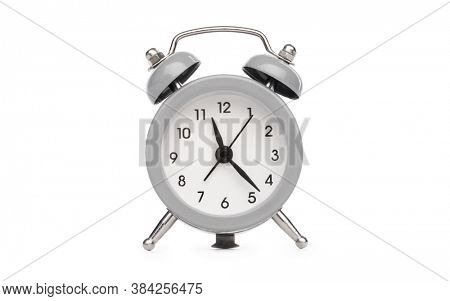 Retro analog table alarm clock with round face isolated on white background