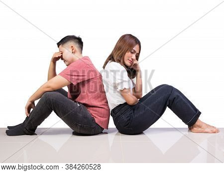 Two Girls And Tomboy Friends Sitting Think On Floor With White Background
