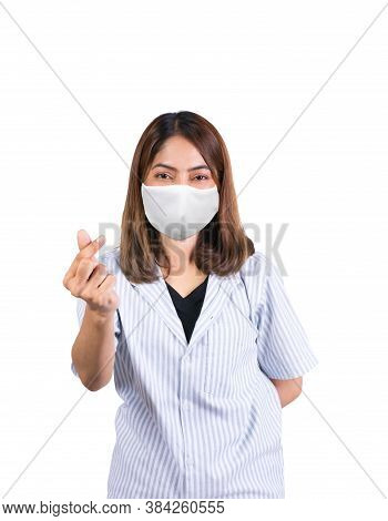 Woman Showing Mini Heart Sign And Wearing Fabric Mask Safety Covid-19 Or Coronavirus On White Backgr