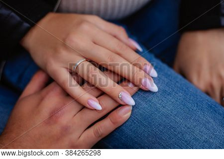 Close Up Black Woman And Man In Love Sitting On Couch Two People Holding Hands. Symbol Sign Sincere