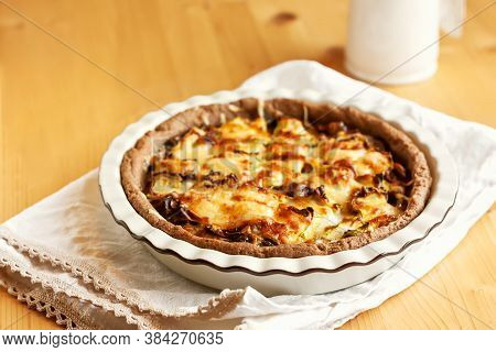 Savory Tart With Mushrooms. Top View Of Mushroom Quiche Pie On Light Wooden Background.