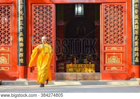 Buddhist Monk Performing Ritual At Fayuan Temple In Beijing, China