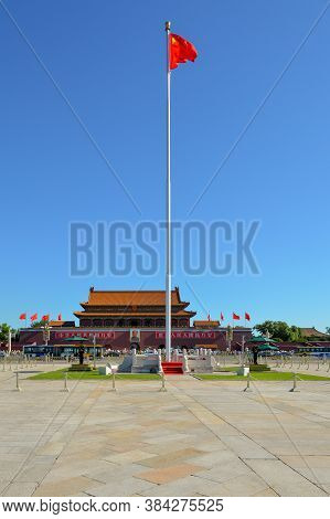 Beijing / China - July 13, 2014: National Flag Of The Peoples Republic Of China At The Tiananmen (ga