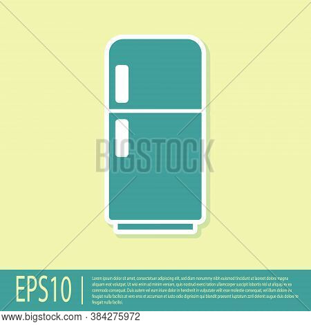 Green Refrigerator Icon Isolated On Yellow Background. Fridge Freezer Refrigerator. Household Tech A