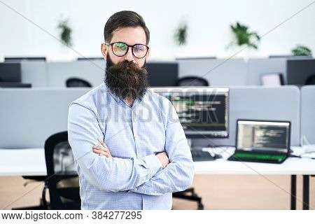 Confident Computer Programmer Developer Standing In It Office Crossing Hands On Chest, Working On A