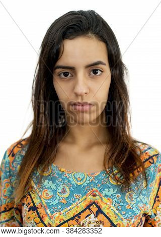 Passport Photo Of Serious Egyptian Female Young Adult On Isolated White Background For Cut Out