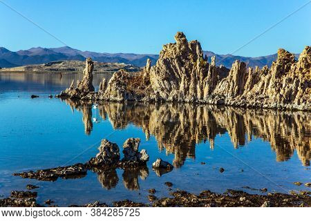 Twilight evening. California, USA. Picturesque Mono lake. The columns - remains of