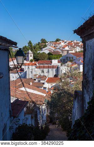 Castelo de Vide, with rooftops and landscape. Santa Maria Church and Dom Pedro seen from Castle Tower. Castelo de Vide, Alentejo, Portugal