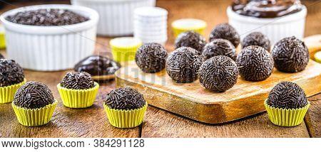 Brazilian Chocolate Truffle Bonbon Brigadeiro On Wooden Table. Sweet Typical Of Children's Parties