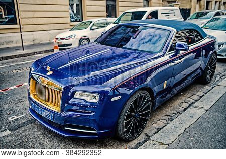 Paris, France - September 26, 23, 2017: Luxury Supercar Rolls Royce Rolls-royce Ghost Blue And Gold