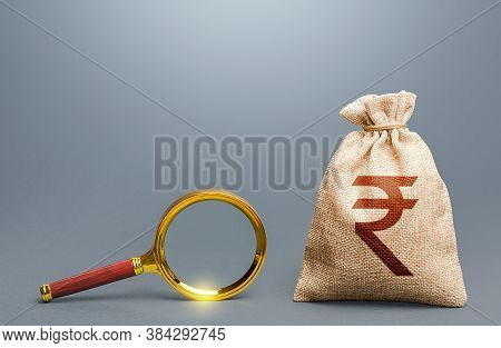 Indian Rupee Money Bag And Magnifying Glass. Find High-paying Job. Most Favorable Conditions For Dep