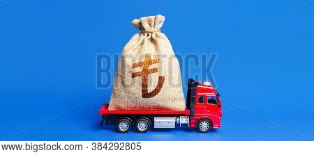 Truck Is Carrying A Huge Turkish Lira Money Bag. Anti-crisis Measures Of Government. Attracting Larg