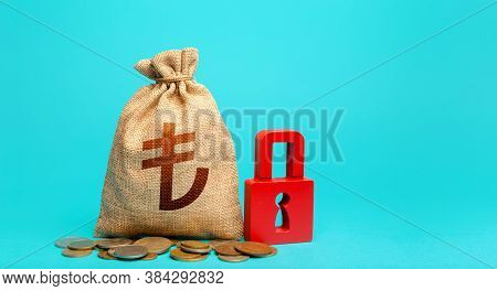Turkish Lira Money Bag And Red Padlock. Blocking Bank Accounts And Seizing Assets. Freezing Of Pensi