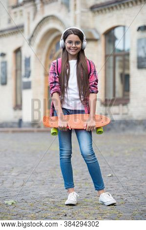 Keep Calm And Love Skateboarding. Happy Child Hold Penny Board Outdoors. Street And Park Skateboardi