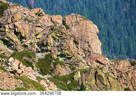 Volcanic Rocky Ridge Overlooking A Vast Alpine Forest Taken At The Sierra Buttes In The Northern Sie