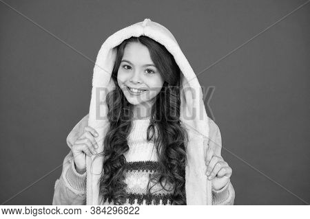 Winter Fashion. Small Girl Long Curly Hair. Child Comfy Hooded Coat. Fashion Collection. Natural And