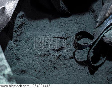A Close Up Of A Black Coal Texture In Bag, Dark Coal Back, Blue Tint