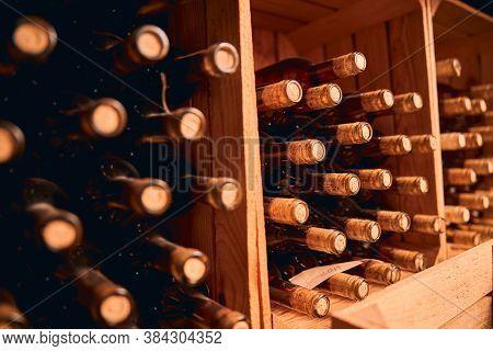 Bottles Of Wine Stored In Wooden Racks