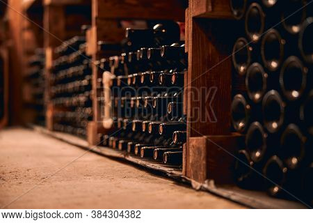 Wine Bottles With Corks Stored In Wine Cellar