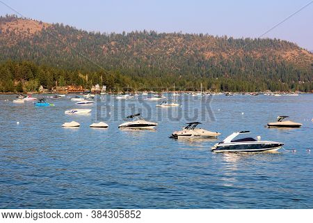 September 4, 2020 In Lake Tahoe, Ca:  Anchored Yachts And Jet Skis Taken Offshore Lake Tahoe, Ca Whe