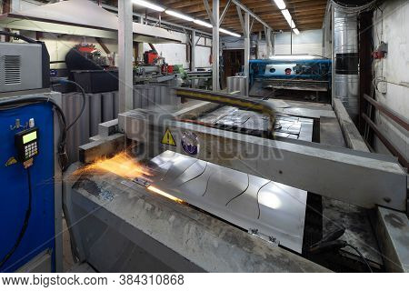 Cut Sheet Of Metal On The Working Machine. Plasma Metal Cutting. Production Of Metal Pipes.
