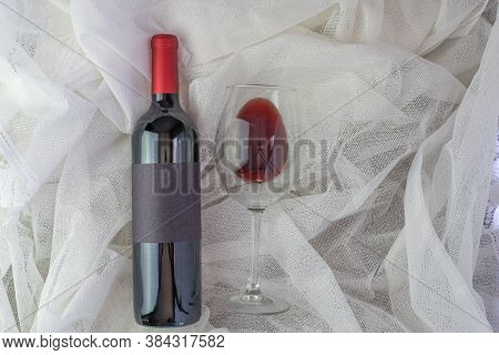 Romantic Composition With Red Wine Bottle Mockup And Glass Of Red Wine