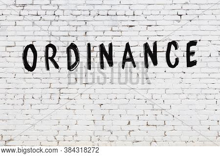 White Brick Wall With Inscription Ordinance Handwritten With Black Paint