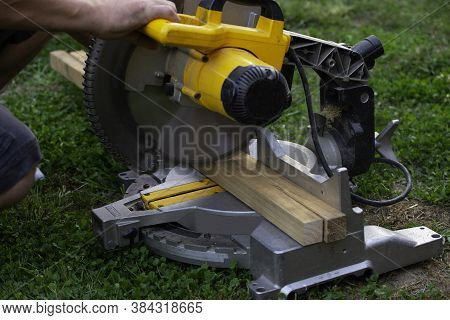 Sawing Construction Materials Building Contractor Worker Using Hand Held Worm Drive Circular Saw To