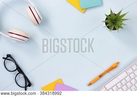 Modern Clean Creative Office Desk Or Table On Top View Or Flat Lay And Stationery As Keyboard,headph