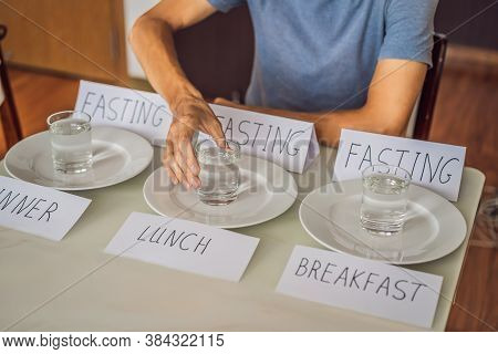The Man Replaces His Meals With Water. Intermittent Fasting Concept, Top View