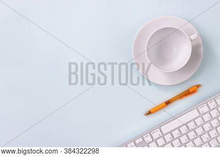 Coffee Cup And Pen And Computer Keyboard On Modern Clean Creative Office Desk Or Office Table On Top