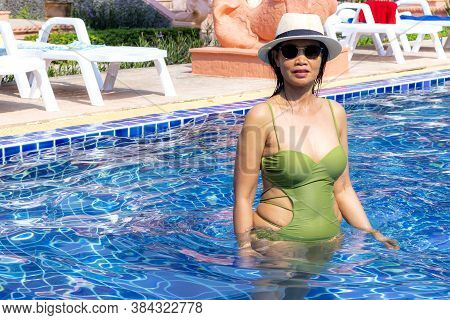 Woman Pretty In Swimsuit And Sunshine On Swimming Pool At Beach Koh Chang Thailand. Koh Chang Is Loc