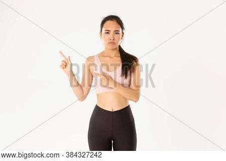 Sport, Wellbeing And Active Lifestyle Concept. Complaining Sad Asian Girl In Activewear, Sulking And