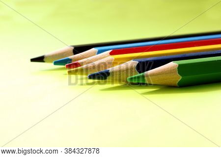 Colored Pencils On A Yellow Background. Lots Of Different Colored Pencils. Colored Pencil. Pencils A