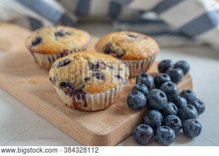 Freshly Baked Blueberry Muffins On A Table