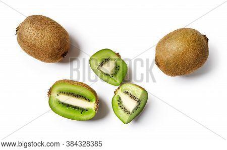 Whole Kiwi And Sliced Kiwi Fruit Isolated On White Background. Top View Of Kiwi Pieces.