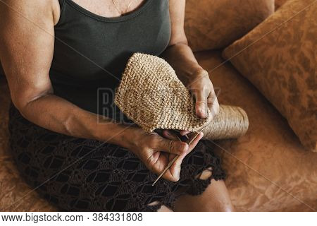 Aged Woman Crochets A Napkin With Natural Thread Inside In Her Living Room. Napkin Close Up, Woman H