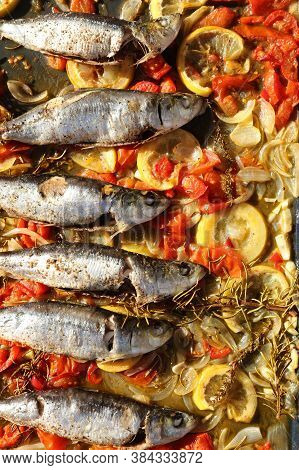 Fresh Sardines With Vegetable On A Plate
