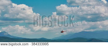 Virgin Nature Landscape. Highland. Explore World. Magnificent Mountains. Helicopter On Cloudy Sky. A