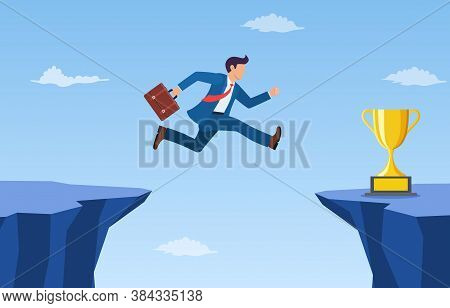 Businessman Jump Through The Gap To Get Golden Trophy. An Employee With A Running Jump From One Clif