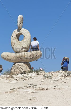 Chernomorsky District, Crimea, Russia - July 21, 2020: Tourists Are Photographed Near The Thinker Sc