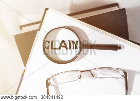 Claim Word On Paper, Lawsuit And Claims Concept