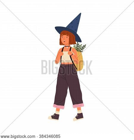 Cute Happy Girl Wearing Witch Hat Carry Backpack Full Of Magical Herbs. Funny Portrait Of Joyful Lit