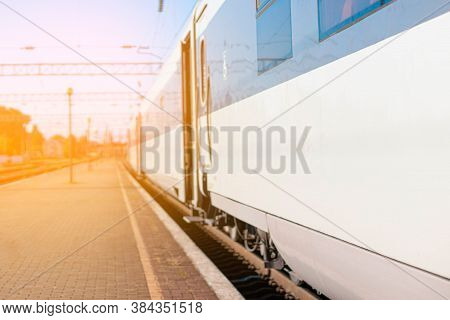 High-speed Train On Rails On The Railway Station Platform On Sunny Day. Modern Intercity Train On Ra