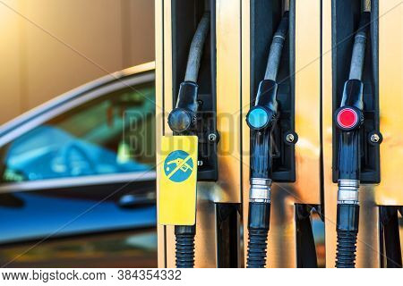 Fueling Pistols, One Of Them Out Of Fuel. Fuel Shortage Concept, Gasoline Out, In The Background Of