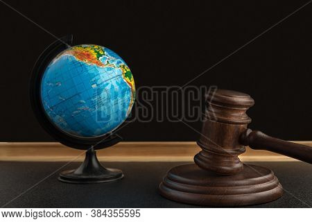 Wooden Judge Gavel And Globe. International Environment Law. Law And Justice Court Concept